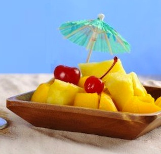 8852351-yellow-red-colored-cocktail-with-cherry-on-the-rim-of-the-glass-and-tropical-fruits-pineapple-mango-